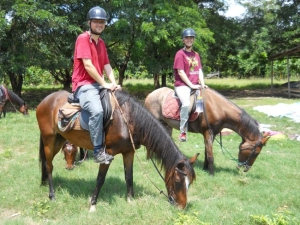 Phil and Adele on horses in Ghana