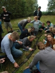 Students examining a sediment core extracted with a Russian corer