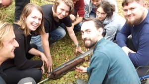 Britte (far left) raises her first sediment core during the Palaeoecology course in 2016!